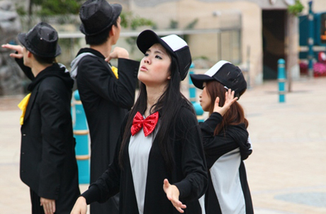 Caption: Dancers at Ocean Park demonstrate their penguin dance moves.
