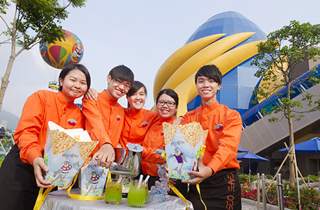 Photo 3 & 4: Graduating trainees demonstrate the preparation of a special drink in front of the Park's new Grand Aquarium