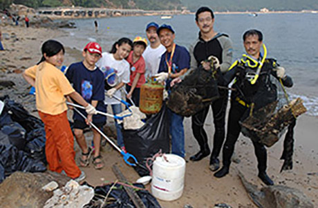 Volunteers gathering up litter for Ocean Park Coastal Cleanup Activity.