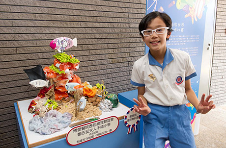 Pic 3: The Award for Best Use of Recycled Materials goes to A.D. & F.D. of Pok Oi Hospital Mrs. Cheng Yam On Millennium School