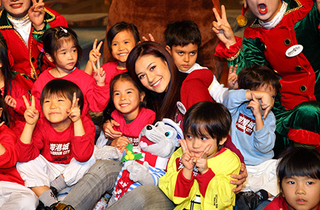 Photo 3: Elanne posing with a group of lovely kids