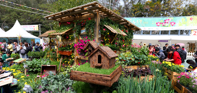 Photo 1: The farm cabin displayed was made from recycled wood boards