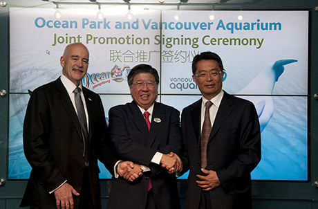 Mr. John Nightingale, President of Vancouver Aquarium, Mr. Paul Pei, Executive Director, Sales and Marketing of Ocean Park Hong Kong and Mr. James Ho, Board Director of Vancouver Aquarium pose for a photo at the official signing ceremony