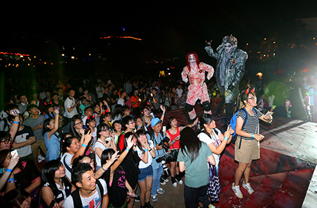"Photo Caption: More than a thousand chic visitors joined hip ghouls and ghosts in a large-scale ""Gangnam Style"" dance last Saturday, creating hauntingly memorable Halloween moments together."