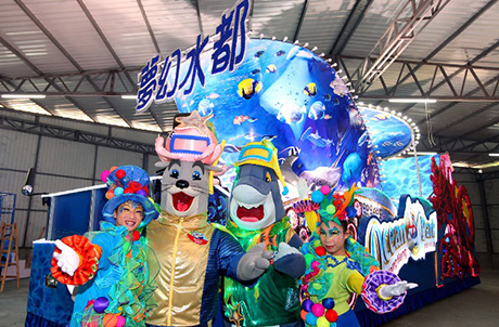 Photo 2 & 3: Ocean Park mascots Whiskers and James and fellow performers pose in front of the Float