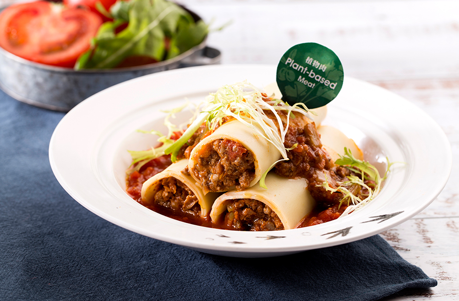 New Style Cannelloni - Meatless ground crumble is wrapped in cannelloni and served with fresh tomato paste for an innovative green dish.
