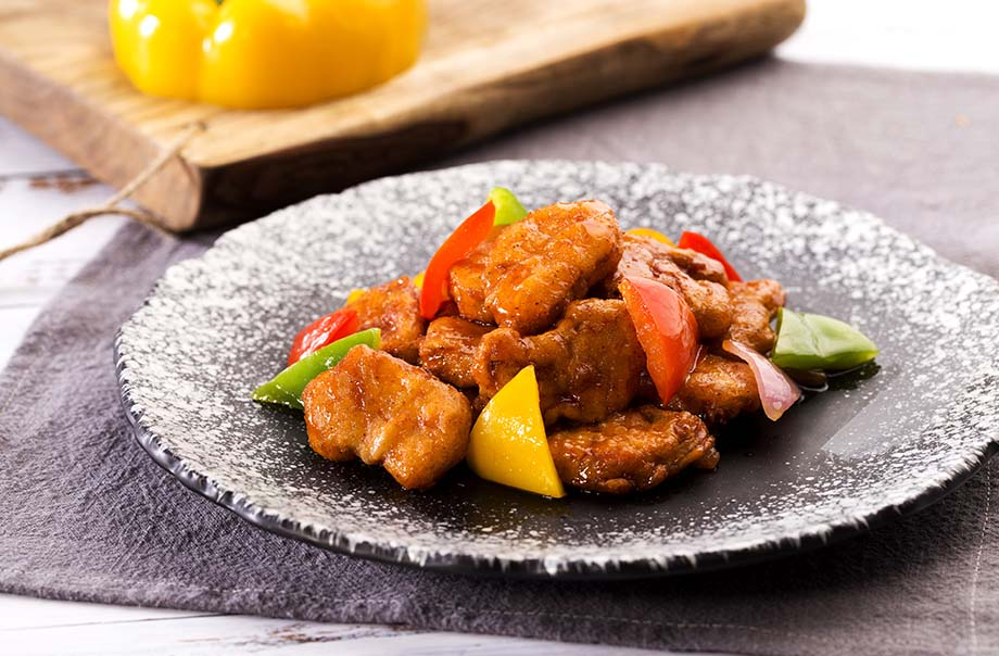 Tricky Chick'n Pieces - A classic dish made with plant-based chick'n pieces, pineapple, bell pepper, onion, and sweet and sour sauce. Feels and tastes like real chicken.