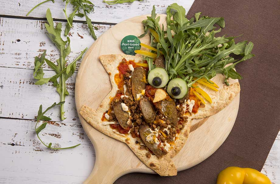 Surprising Pizza - The 100% plant-based beyond sausage is made from beyond meat comprising beetroot the superfood, and dairy-free mozzarella cheese and cheddar cheese.