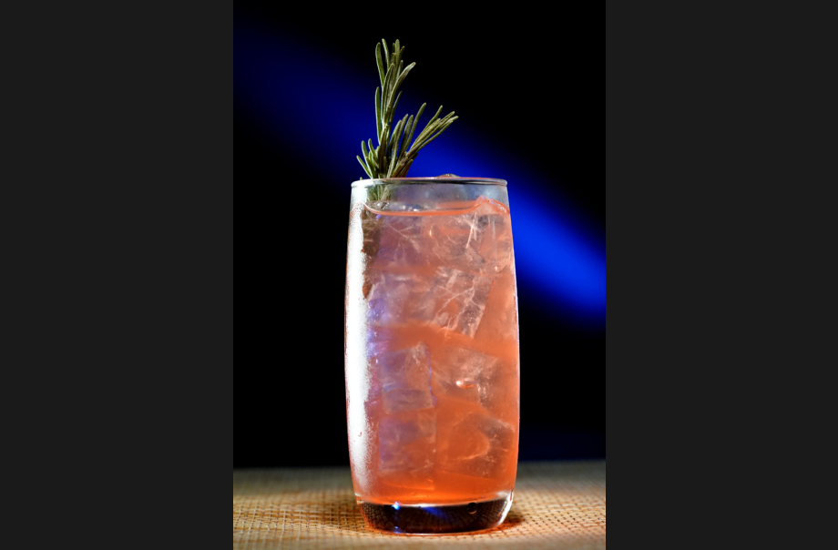 Strawberry & Coconut Cooler (Ingredients: Strawberry Puree, Rosemary Sprig, Coconut Water, Lemon Juice)